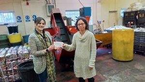 Kerry Davies of the Leofric Lions hands a cheque to Crow Recycling's Lucy Lynch