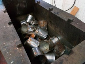 Steel cans in a crusher